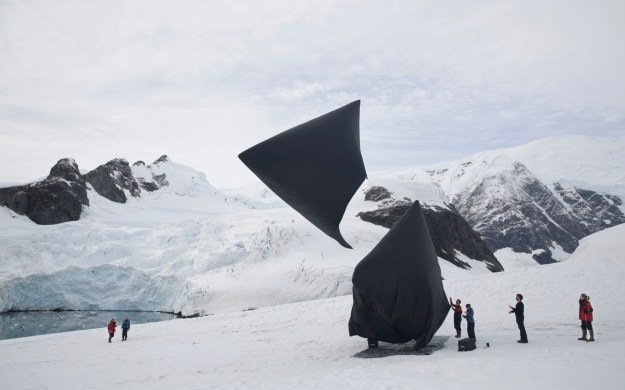 """1. Argentine artist Tomás Saraceno's """"Aerocene,"""" a solar-powered kite which functions like a hot-air balloon, muses on the impact of air travel on climate change and presents a futuristic, sustainable solution to the universal human desire to fly. / 2. Joaquín Fargas' """"Glaciator"""" robot, which compress snow into ice to accelerate the formation of glaciers."""