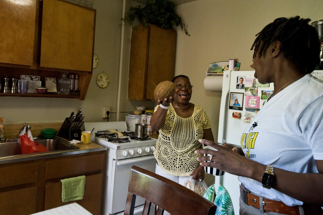 Sara Martinez and Justa Gil in the kitchen.