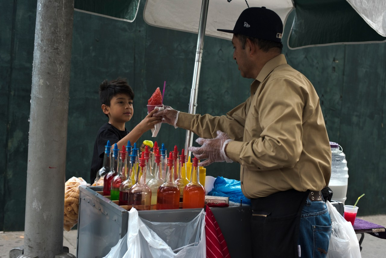 Juan serves a young customer in Corona, Queens.