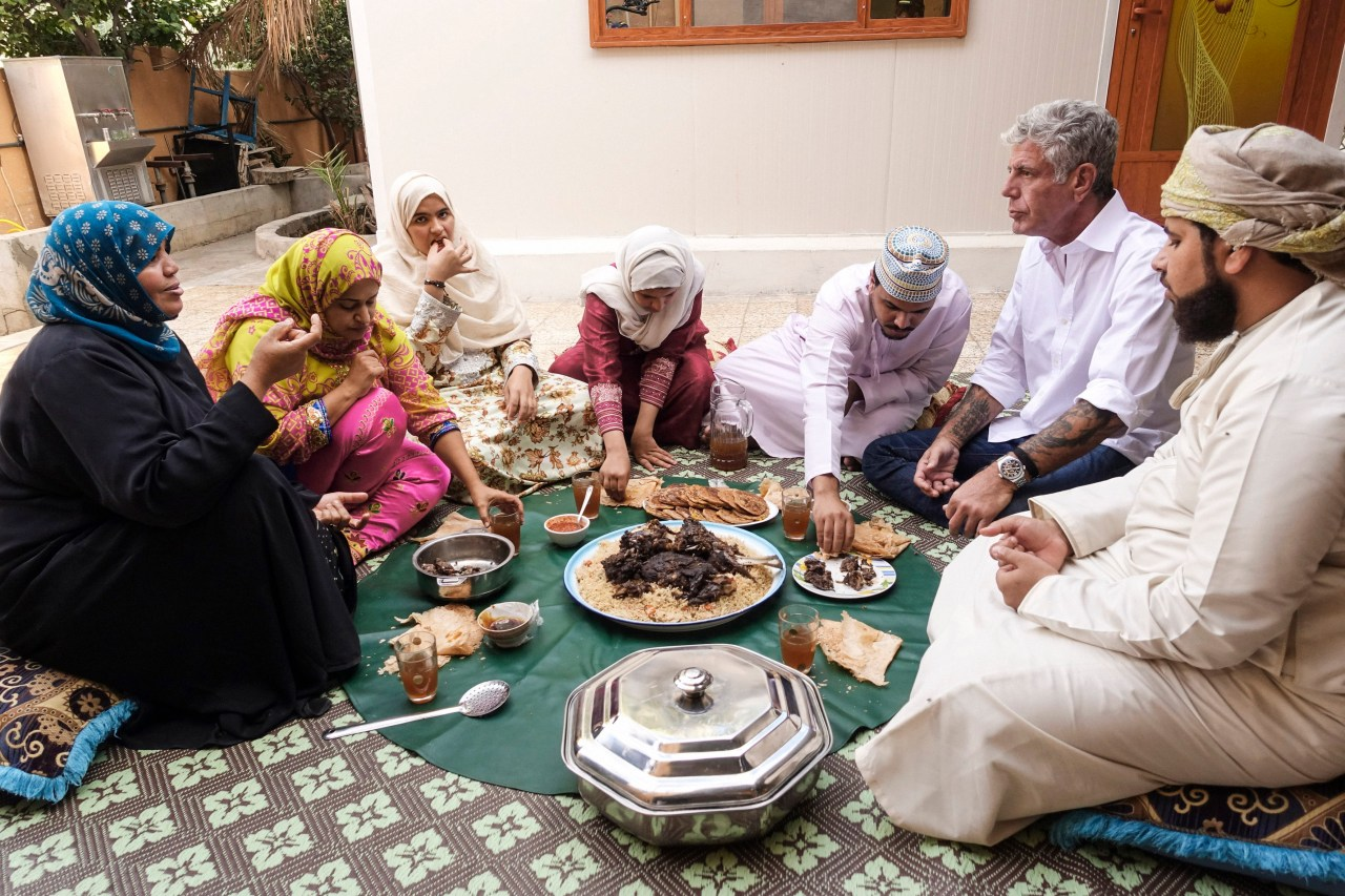 Bourdain joins Zahara as-Awfi and her family for a meal at their home in Al Hamra.