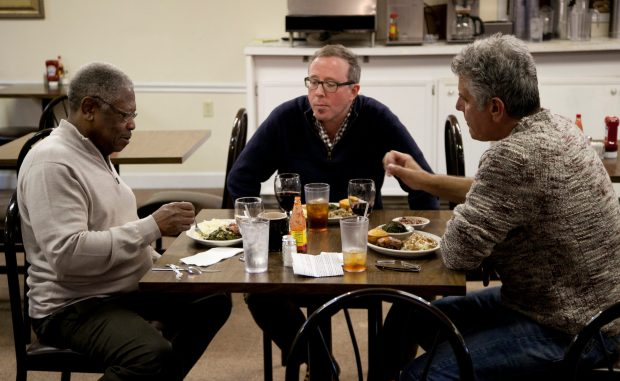 """Bourdain and John T. Edge (middle) join Senator Willie Simmons (left) for lunch at his restaurant, """"Senator's Place"""" in Cleveland."""