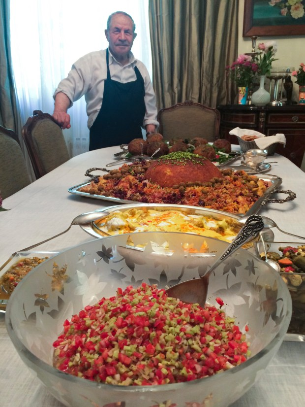 Nazila Noebashari's cook, Rahim, with the beautiful feast he created. (Photo by Erik Osterholm)