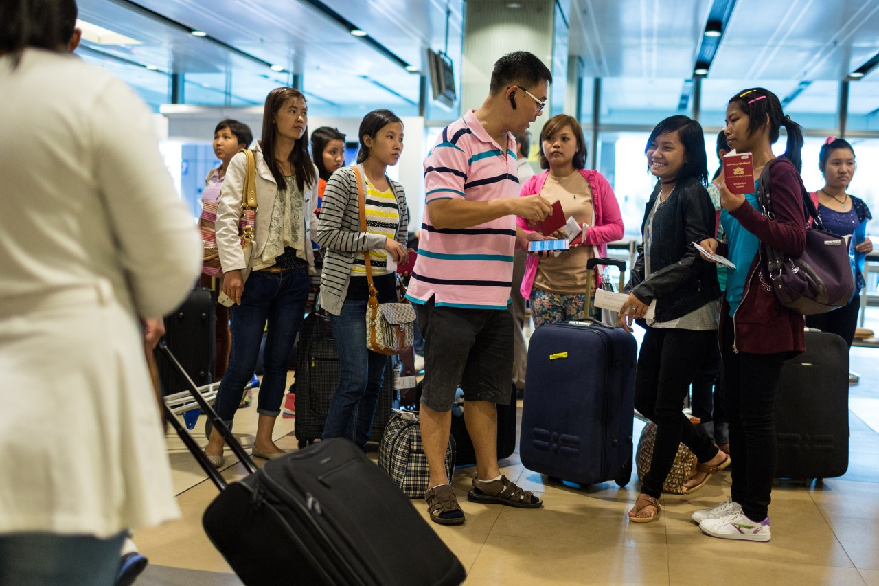 "A ""runner"" picks up domestic workers at the airport. ""Runners"" take women to do their medical test, ""Settling in Program"" and registration at the Ministry of Manpower—the necessary steps to start working in Singapore."