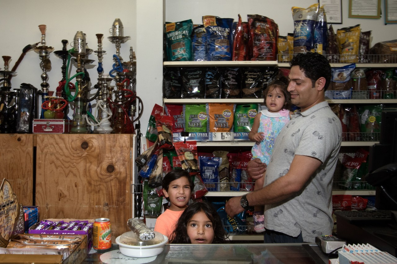 Hamad Abdelrahman with his children at one of the two islamic grocery stores in Murfreesboro.