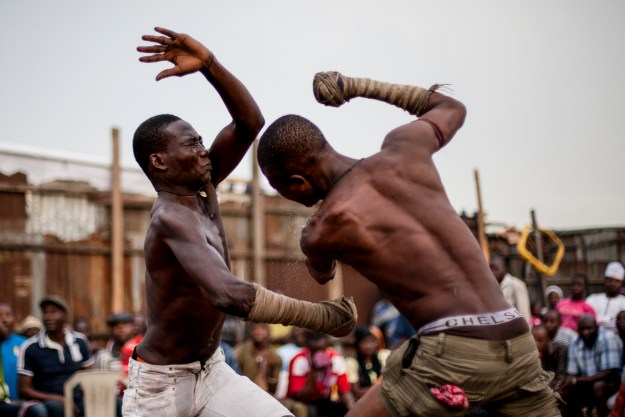 1. Hassan Abu Trassan, 22, (L) attempts to block a strike from 'Shago' Abatamai Chikba, 21, (R) during a match in Lagos. / 2. Autan Sikido, 27, originally from Kaduna State, prepares to strike during a match.