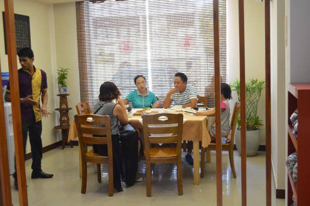 1. A Chinese family dines at Tang Dynasty. / 2. Derrick Wang (left), the proprietor of Grand Beijing along with the executive chef, Sun Bouchao. Both Wang and Bouchao have spent many years in Sri Lanka