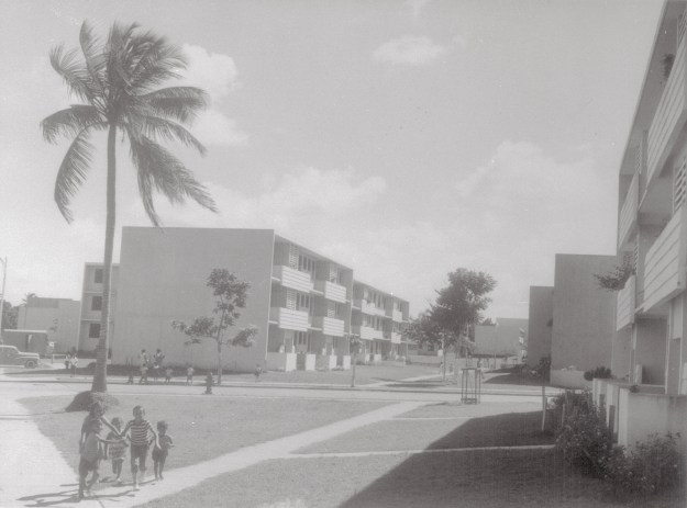 1. Multiple-dwelling public housing units like this modern group are found in the outskirts of the cities and towns. / 2. A 12-acre tract near San Juan when construction was beginning on houses for 131 families as part of a works relief and slum clearance project, the first public housing in Puerto Rico. (Both photos by Bettmann via Getty Images)