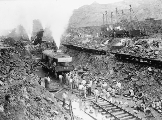 Steam shovel trains excavate the channel of the Panama Canal c. 1913 (Photo by Buyenlarge via Getty Images)