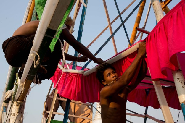 About 20 people between 17 and 70 years old, including technicians, cooks, Ferris wheel operators, and accountants, work for the Myint Thamada group.