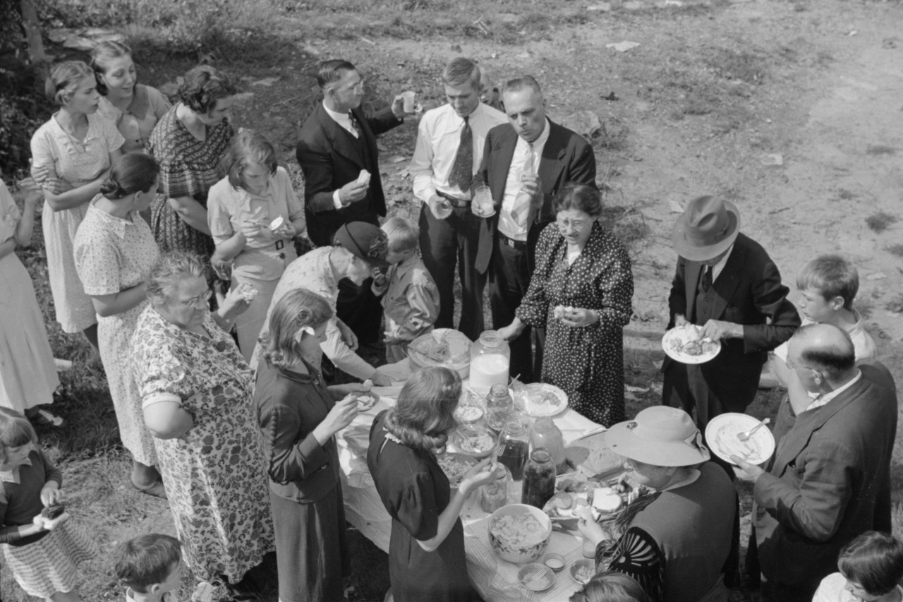 Residents of Jere eat at a Sunday school picnic brought to their town by neighboring parishes, September 1938. Photo by Marion Post Wolcott.