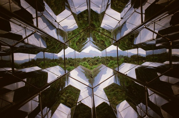 """Photo 1: Visitors take turns operating """"Viewing Machine"""" by Icelandic-Danish artist Olafur Eliasson. Photo 2: A glimpse of the regional landscape through Olafur Eliasson's """"Viewing Machine."""""""