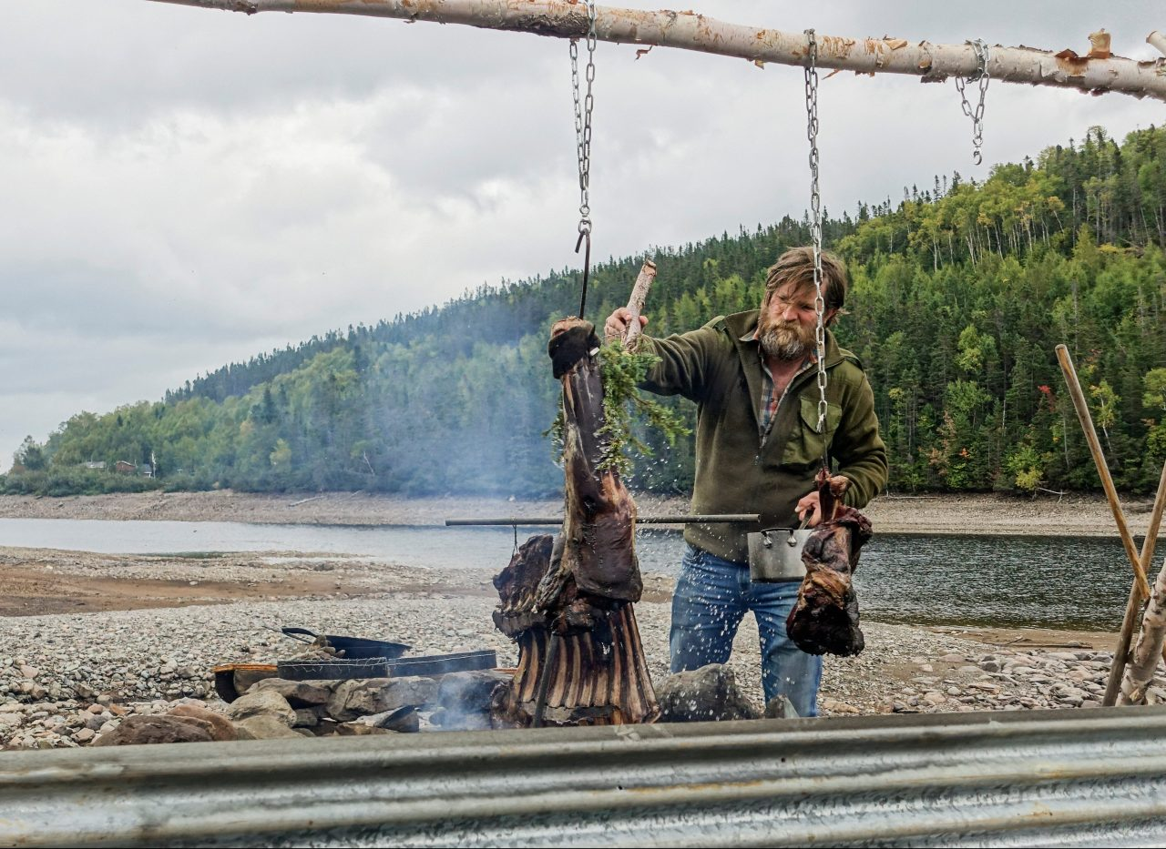 Charles cooking moose meat while shooting Parts Unknown. Photo by Danny Beaser.