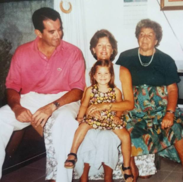 The author (center) in 1993, with her grandmother and parents. Photo courtesy of Lola Méndez.