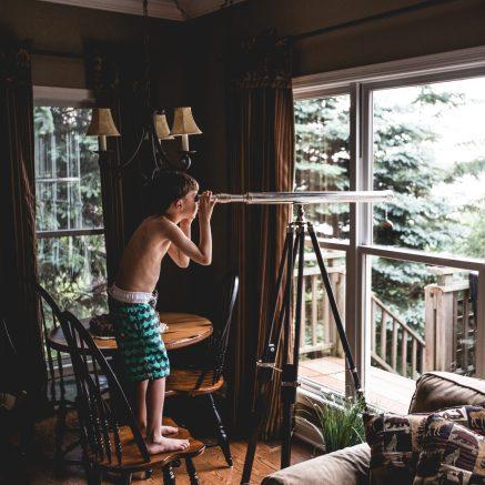 Boy with a telescope by Teddy Kelly