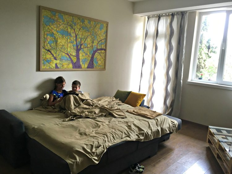 Tbilisi Airbnb living room with kids on the couch
