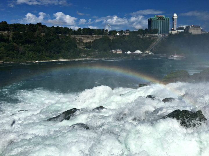 Rainbow over the crash of the falls. Niagara Falls with kids is the perfect family vacation. #operationusparks #explorermomma