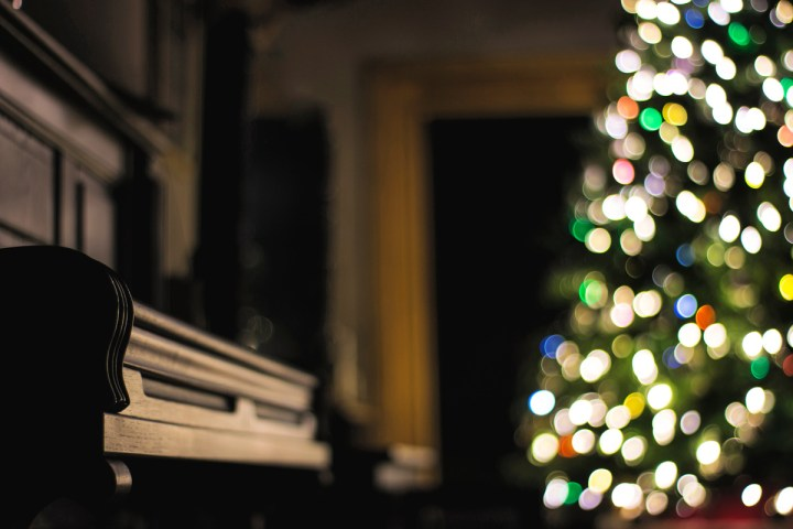 Christmas tree and piano. Families love Christmas traditions together like music and baking. #christmastraditions #christmasbaking