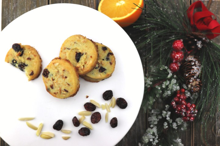 Keto cranberry orange shortbread cookies overhead, with cranberries and almonds #lowcarbcookies #cranberryorange