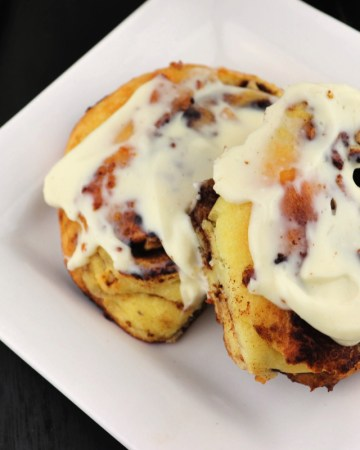 Keto cinnamon rolls, two on a white plate