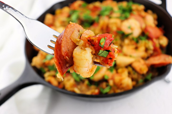 A bite of keto jambalaya will have you wanting more. Gluten-free and low carb, a spicy one-pot meal. #lowcarbrecipes #ketocajun