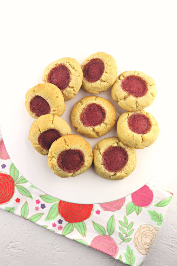 Low carb keto thumbprint cookies are absolutely melt-in-your mouth low carb delish. The perfect gluten-free, sugar-free kid-friendly cookie for all the holidays. #ketoholidays #lowcarbrecipes