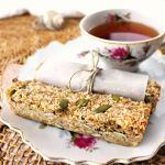 Low carb coconut granola bars are coconut, maple, and pumpkin seed goodness. Perfect keto breakfast or snack for on the go. Gluten-free and sugar-free! #lowcarbgranolanar #lowcarbrecipes