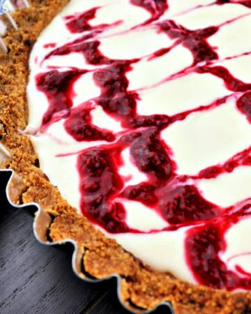 The best almond raspberry keto bakewell tart. A super special low carb dessert sure to impress. With a gluten-free almond flour crust and sugar-free frangipan filling, it's sure to be a hit! #ketodessert #lowcarbrecipes