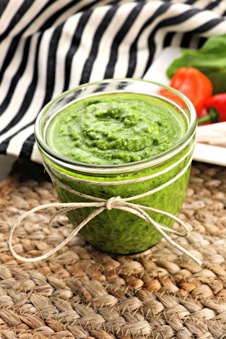 Quick and easy keto pesto is packed with flavor and the perfect sauce to spice up a low carb meal. Gluten-free and sugar-free but full of garlic and basil, this will become a summer staple in your house. #ketopesto #ketorecipes