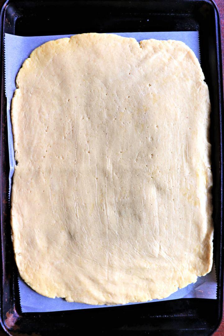 Keto pesto pinwheels dough in a rectangle shape