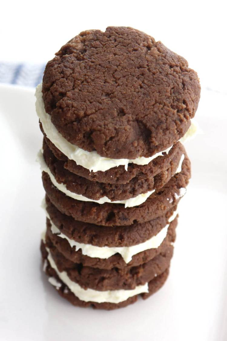 Low carb keto chocolate sandwich cookies are a delicious gluten-free sweet treat. Curb those cravings and enjoy a sugar-free keto way of eating. #lowcarbdesserts #ketorecipes