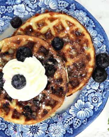 Delicious blueberry chaffles are a fabulous keto low carb breakfast! Gluten-free with classic blueberry morning flavor. #chaffles #ketochaffles #ketobreakfast