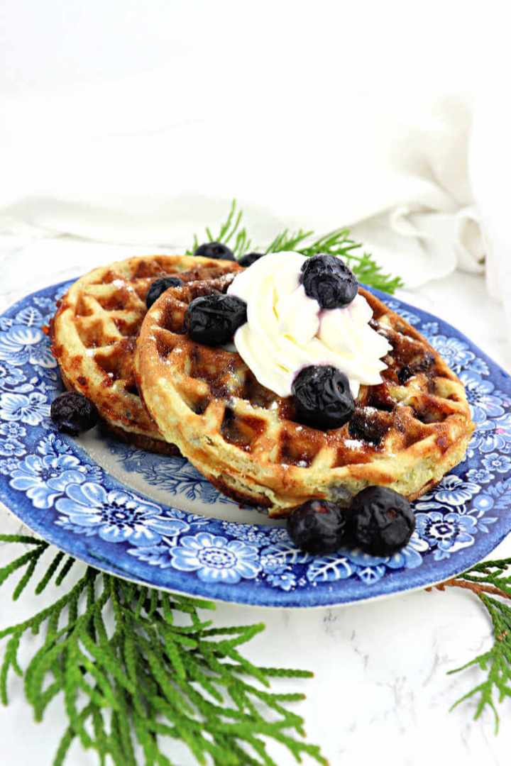 Low carb blueberry chaffles are super-easy and delicious. A quick keto diet breakfast everyone will love and not know it's gluten-free and sugar-free. #ketobreakfast #chaffles #blueberrychaffles