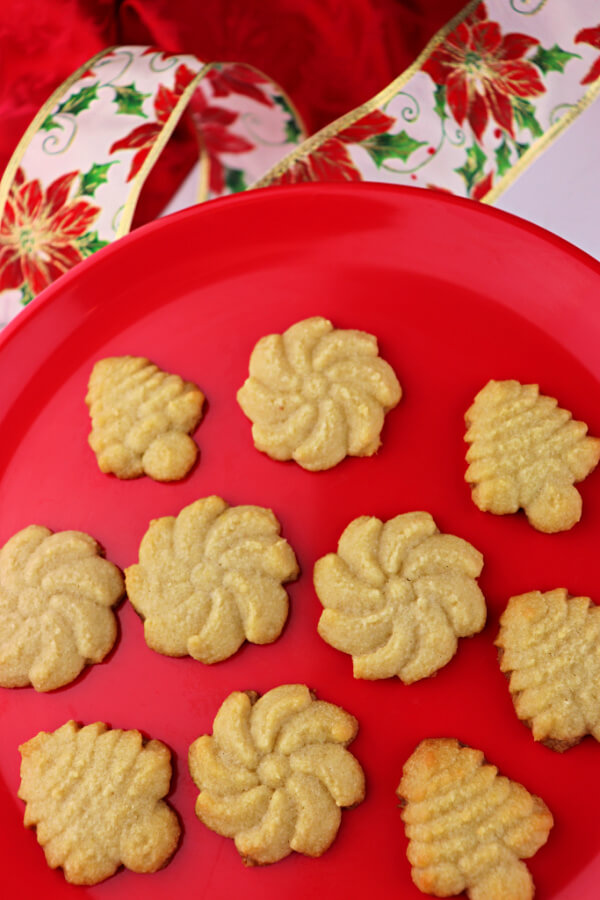 Keto Butter Spritz Cookies are the perfect Keto Christmas cookies. Soft and buttery gluten-free goodness. #ketocookies #ketochristmas