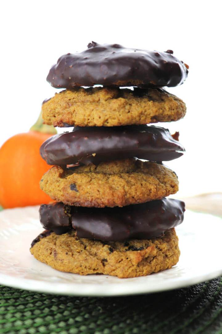 Keto pumpkin cookies dipped in sugar-free chocolate for the win! Low carb, sugar-free, gluten-free delights of spice. #ketorecipes #ketocookies