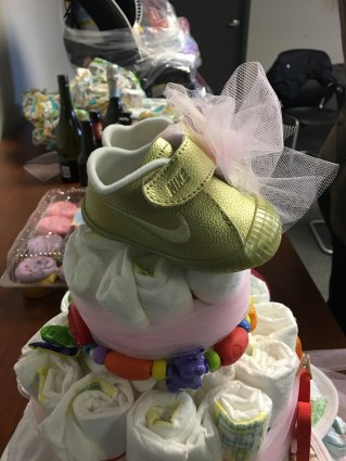 Golden Nikes atop a diaper cake, it doesn't get much better!!