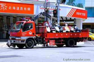 Tow away truck for illegally parked scooters in Hsinchu Taiwan Ouch