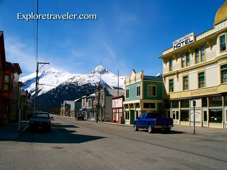 Alaska Photo Tour Part I - A building that has a sign on the side of a road - Skagway