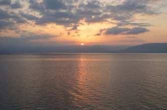 The morning light on the Sea of Galilee in Israel - A sunset over a body of water - Apartment