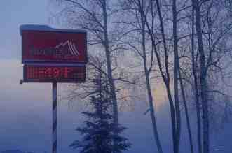 The Roots Of The Iditarod Trail Sled Dog Race - A sign on the side of a lake - Iditarod Trail Sled Dog Race