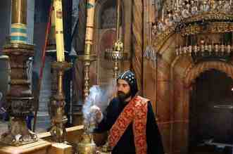 Christians Experience Holy Week In Jerusalem - A statue of a person - Church of the Holy Sepulchre