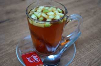Travel the World Recipes ~ Hot spiced Apple Cider in Amsterdam - A cup of coffee and a glass of beer on a table - Drink