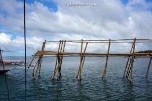 Pangingisda Sa Pilipinas - A bridge over a body of water - Malapascua