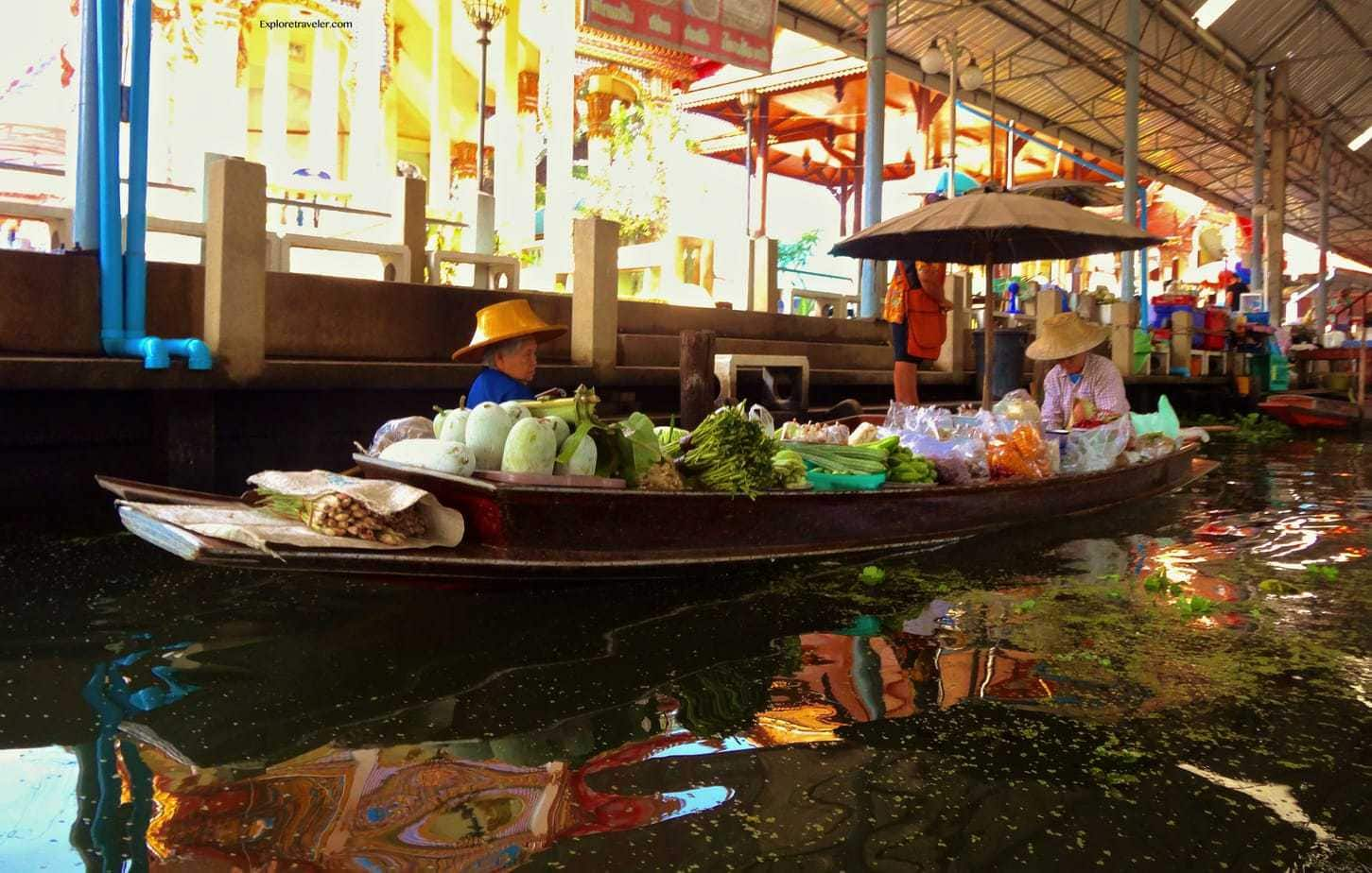 Selling vegetables along the Damnoen Saduak Floating Market