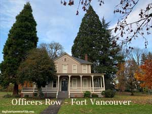 Huge fir trees behind officers home
