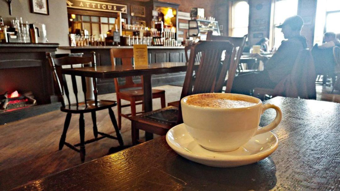Atticus Coffee Shop Spokane Coffee in mug on wooden table.
