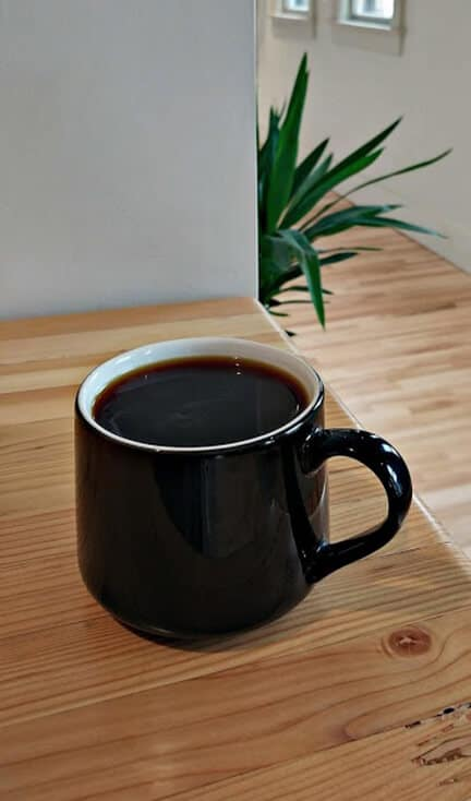 Ladder Coffee Roasters Spokane Coffee in black coffee mug
