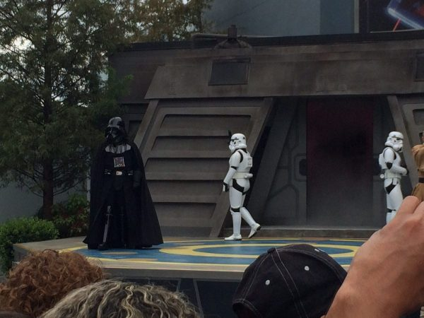 Darth Vader and a Storm Trooper on stage during Jedi Training: Trials of the Temple