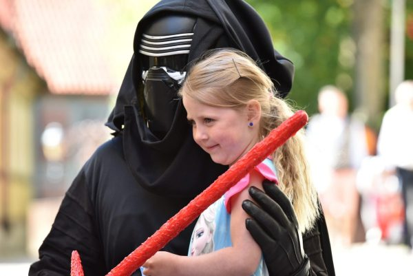 A little girl doing a meet and greet with Star Wars characters