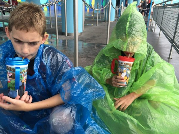 Waiting in line for the buses, while wearing our ponchos