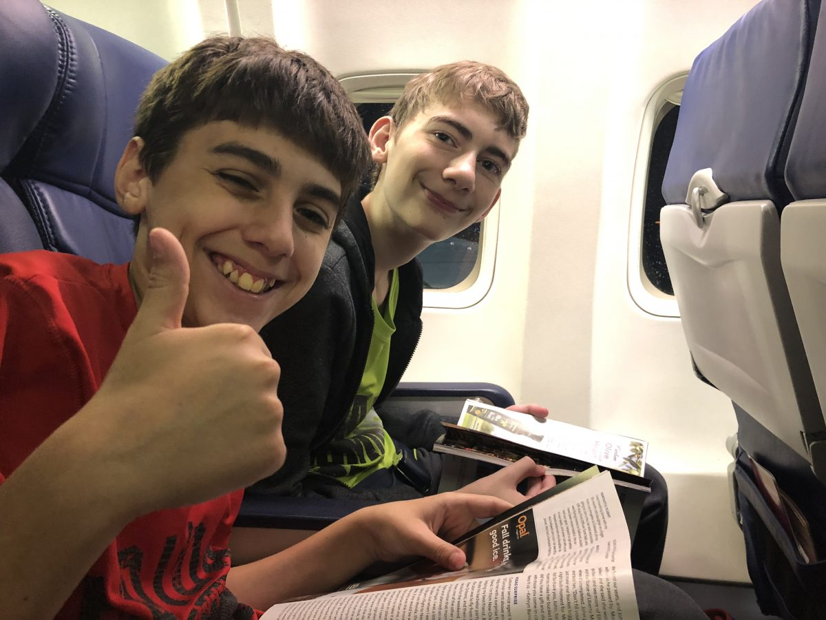 Boys sitting on an airplane, waiting for take off